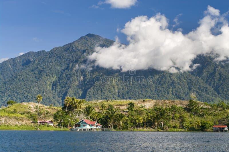 House on an island on the lake of Sentani. New Guinea stock image