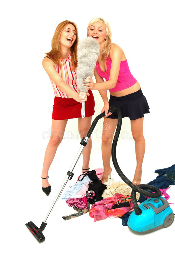 House-keeping fun 1. Young attractive house-wives having fun with the cleaning tools royalty free stock photos