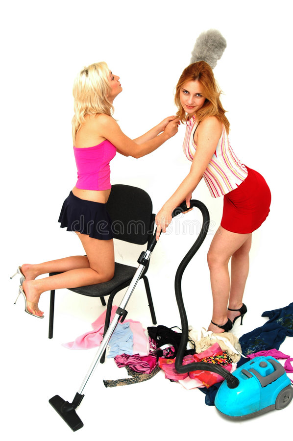 House-keeping fun 4. Young attractive house-wives having fun with the cleaning tools royalty free stock photo