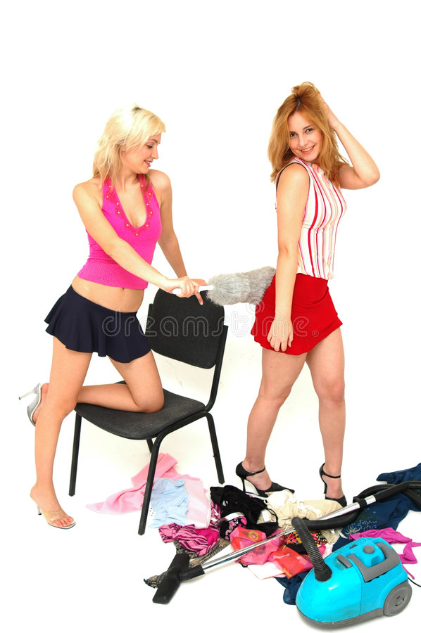 House-keeping fun 5. Young attractive house-wives having fun with the cleaning tools stock images