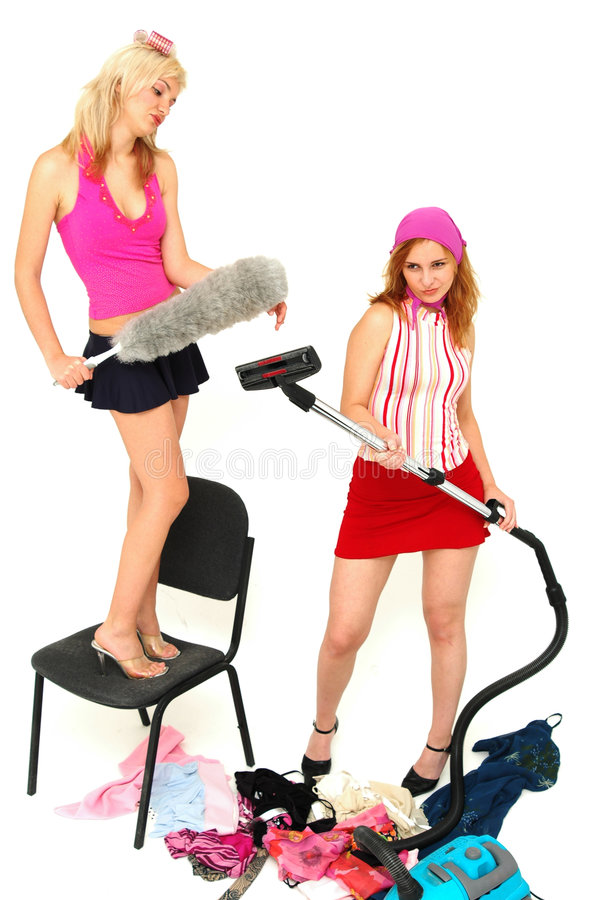 House-keeping fun 6. Young attractive house-wives having fun with the cleaning tools stock photos