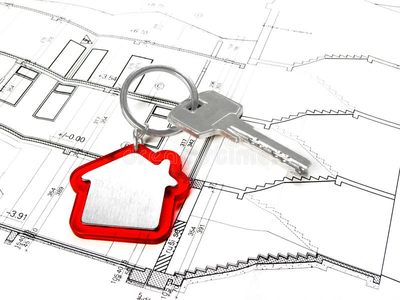 House key. On architectural floor plans royalty free stock image