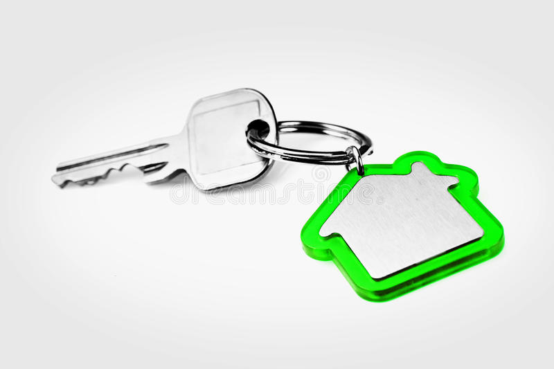 House key. With a blank green key ring, fob for your logo or graphic royalty free stock photo