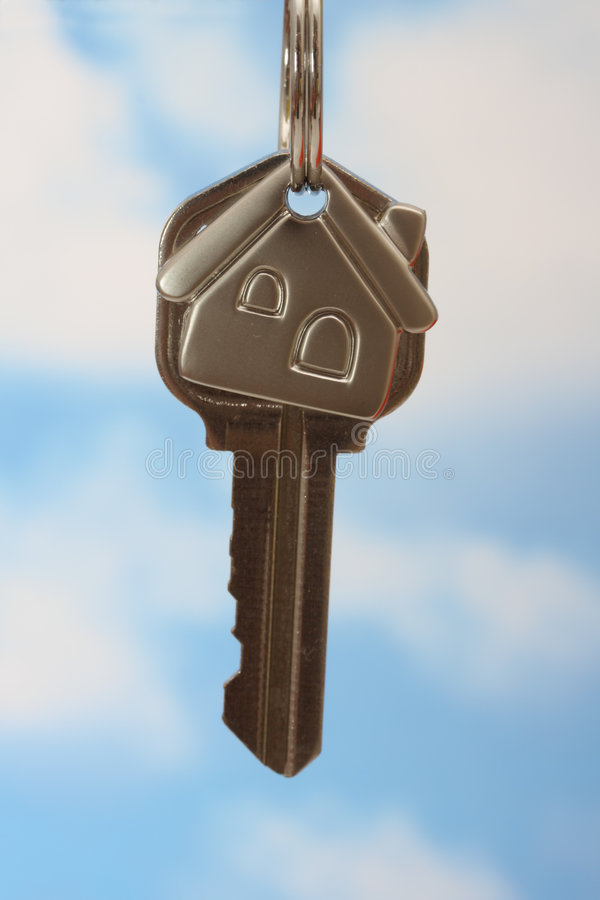House Key. Silver house key on keychain stock images