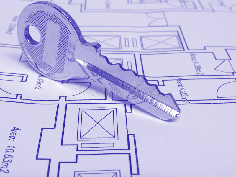 House Key. Architecture and real estate concept: House key on a house plan (Blue tone stock image