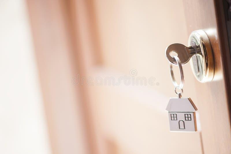 House key in the door stock image