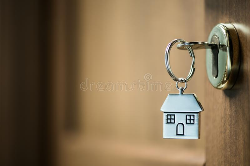 House key in a door. Silver house key in a door stock image