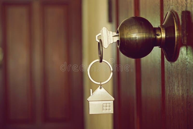 House key in the door. House key in wooden front door stock images