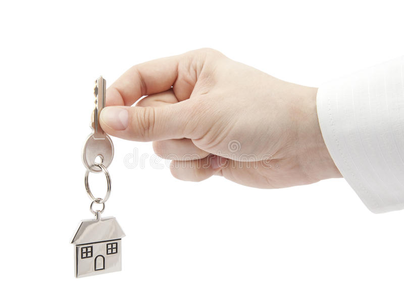 House key in hand isolated on white royalty free stock photo