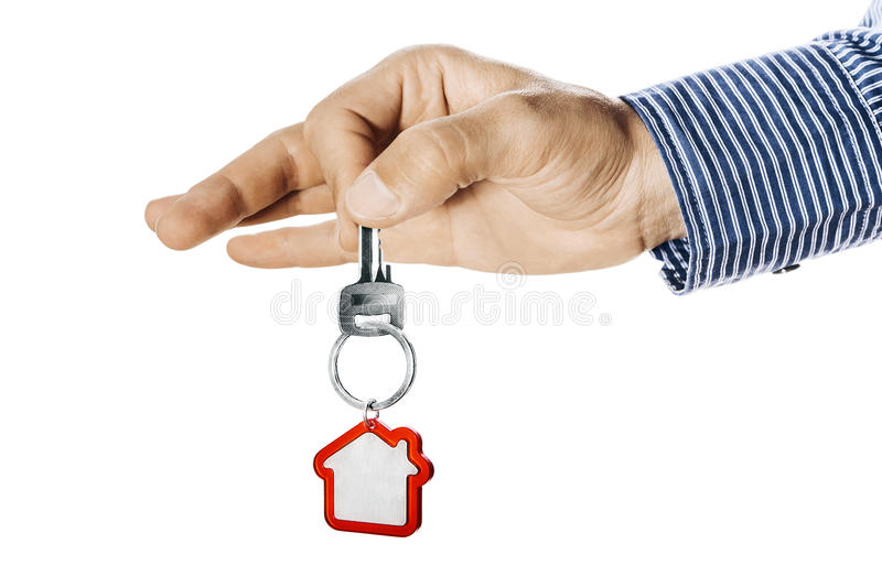House key in hand. Isolated on white stock images
