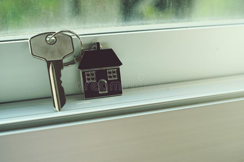 House key with home keyring, real estate concept stock image