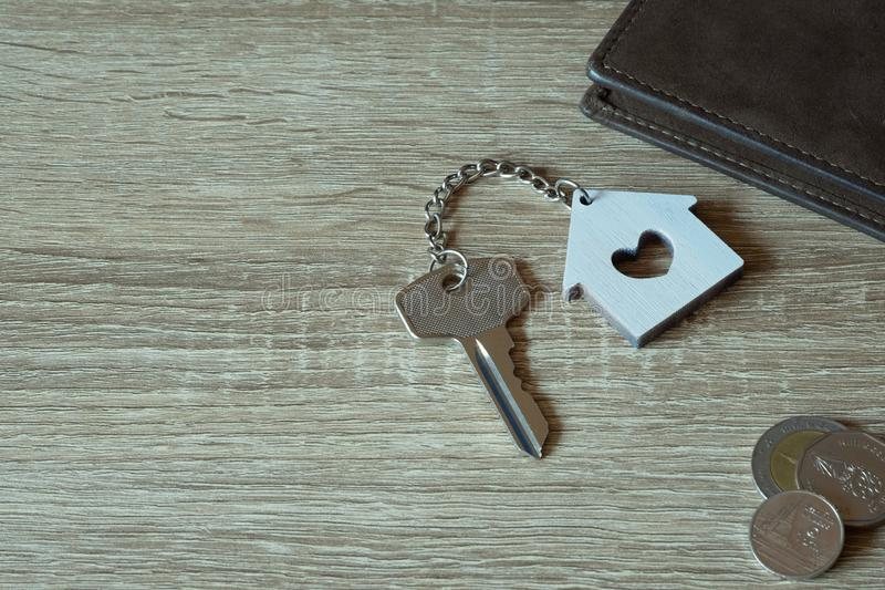 House key with home keyring and wallet on wood table. Copy space unique open chain antique door lock owner keyhole safe secure concept family asset figure stock images