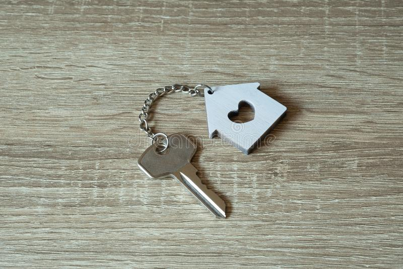 House key with home keyring and wallet on wood table. Copy space, unique, open, chain, antique, door, lock, owner, keyhole, safe, secure, concept, family royalty free stock photos