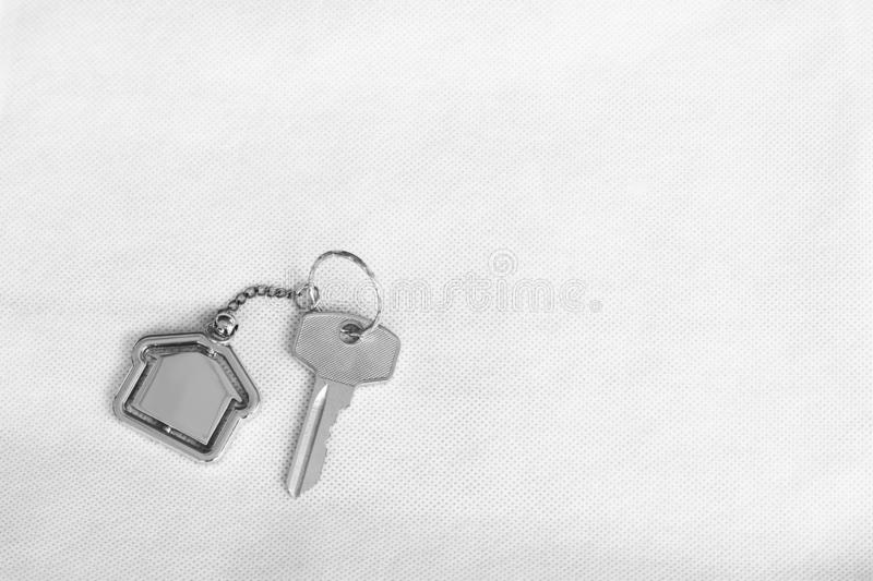 House key with home keyring in on white background. Real estate concept, copy space, unique, open, chain, antique, door, lock, owner, keyhole, safe, apartment royalty free stock photography