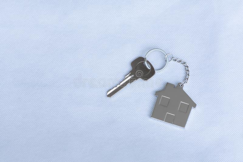 House key with home keyring in on white background. Real estate concept, copy space, unique, open, chain, antique, door, lock, owner, keyhole, safe, apartment royalty free stock image