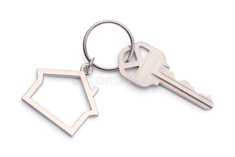 Real Estate Key. House Key With House Keychain Isolated on a White Background stock photo