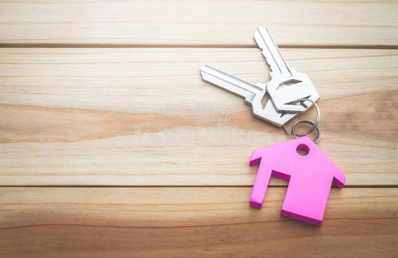 House key on a house shaped keychain concept, moving home or renting property, stock images