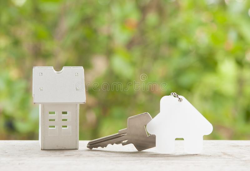 House key on a house shaped keychain. Real estate concept stock image