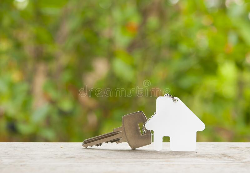 House key on a house shaped keychain. Real estate concept stock photography
