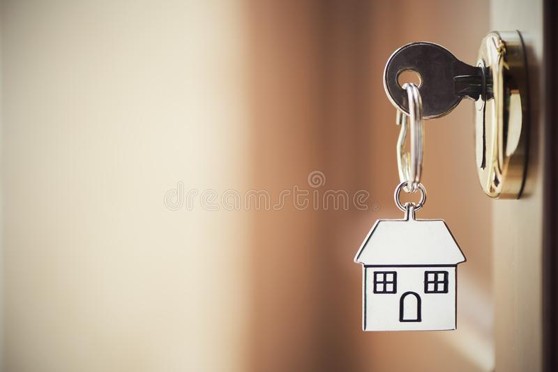 House key in the door stock photography