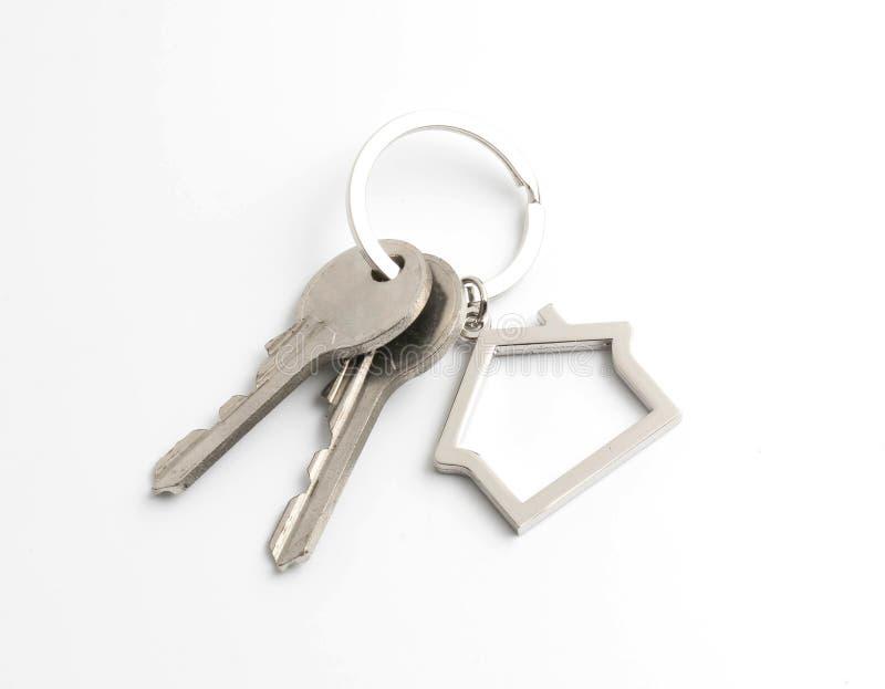 House key isolated on white. Background stock photography