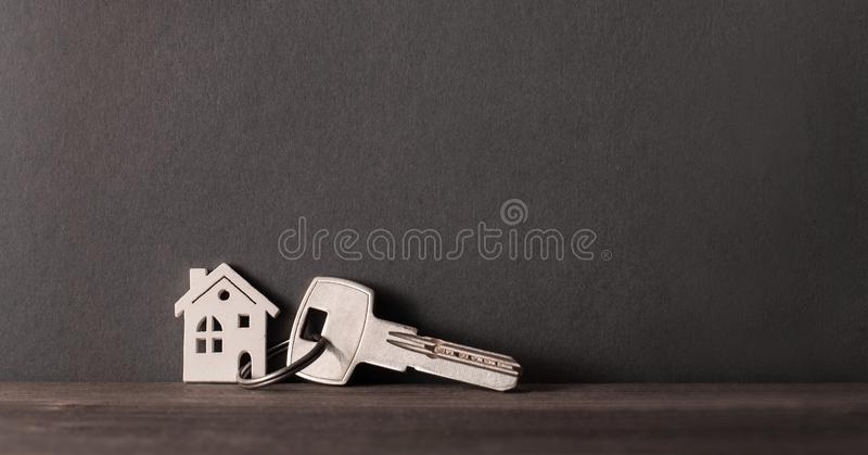 House key and keychain. On grey background royalty free stock photos