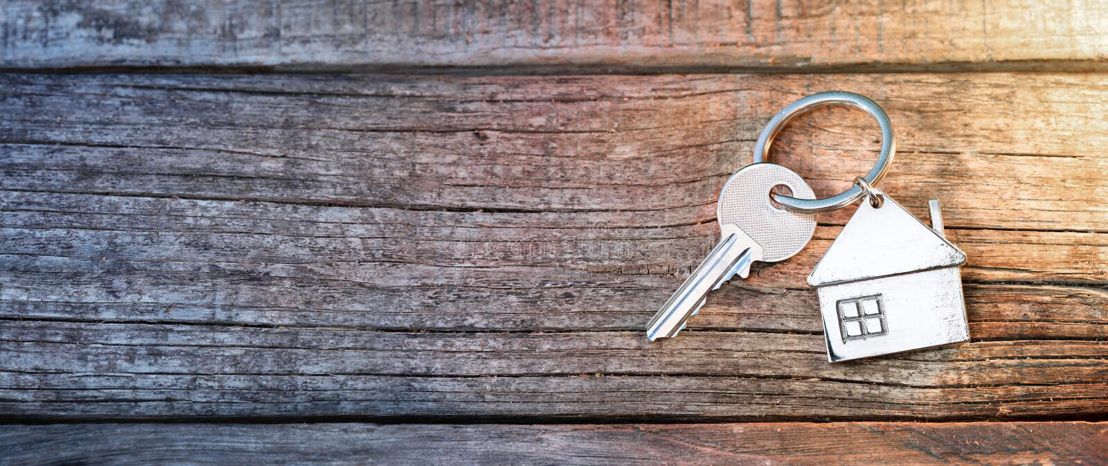House Key And Keychain On Wood royalty free stock image