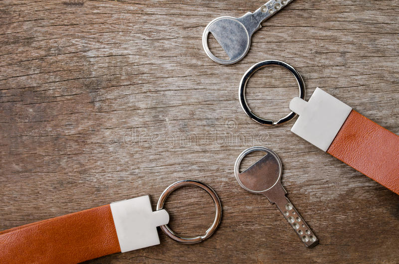 Download House Key With Leather Key Chain On Wooden Background Stock Photo - Image: 83702355