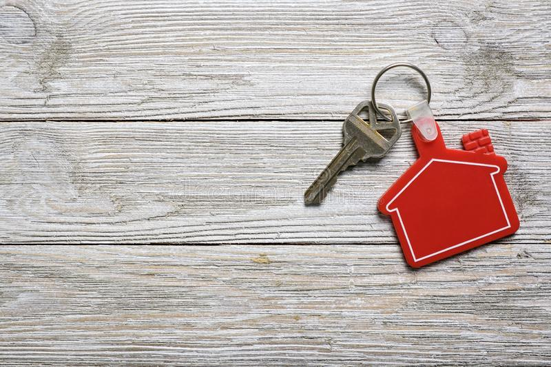 House key with red house shape keychain for real estate concept stock photography
