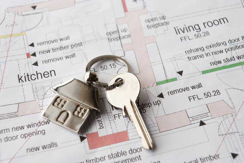 House key on ring. On set of plans stock image