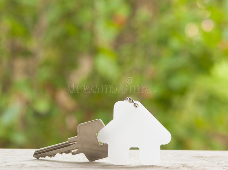 House key on a house shaped keychain. Real estate concept royalty free stock photography