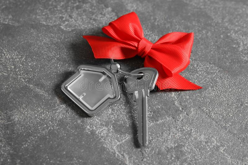 House key with trinket and bow stock photos