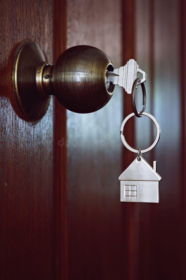 House key in wooden front door. House key in the wooden front door in the morning stock photos