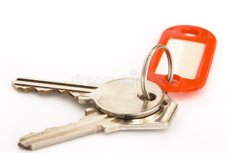House keys 2. A pair of house keys with a blank tag stock photo