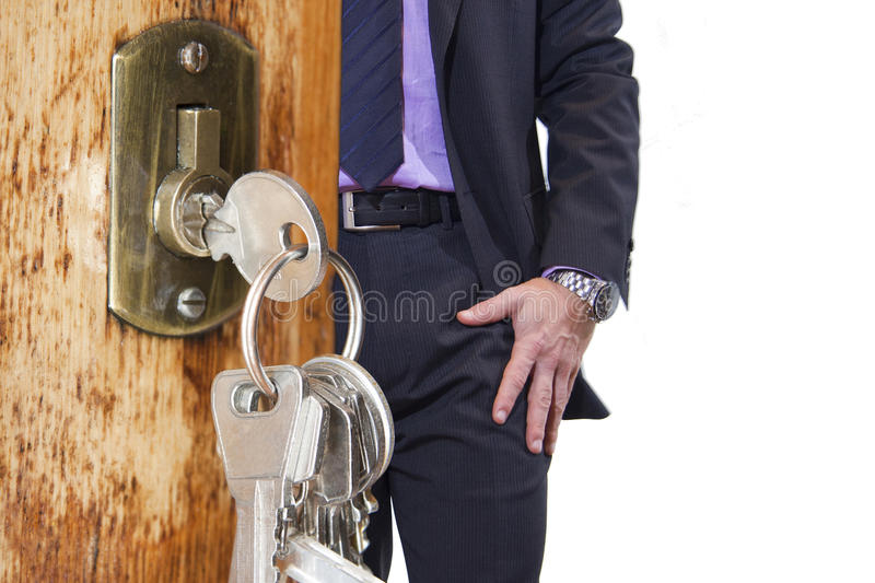 House keys. Front door with keys and a man looking for keys in your pocket royalty free stock photos