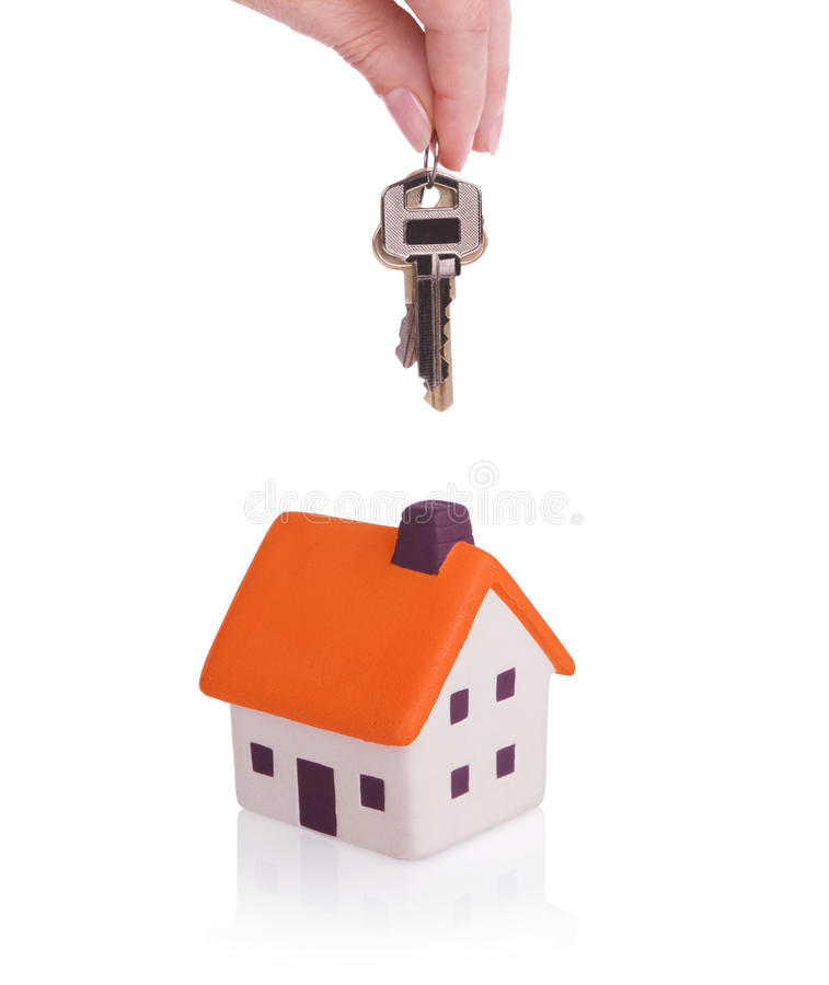House and keys. Conceptual image with small house and keys.Isolated on white royalty free stock photography