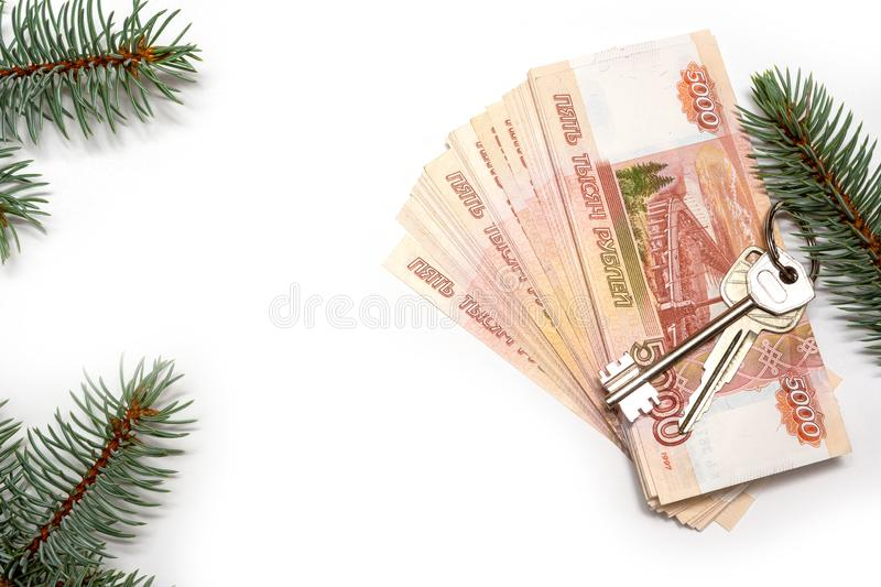 House keys on the background of Russian money. Sale of real estate in an ecologically clean place. The concept of investing money royalty free stock photos
