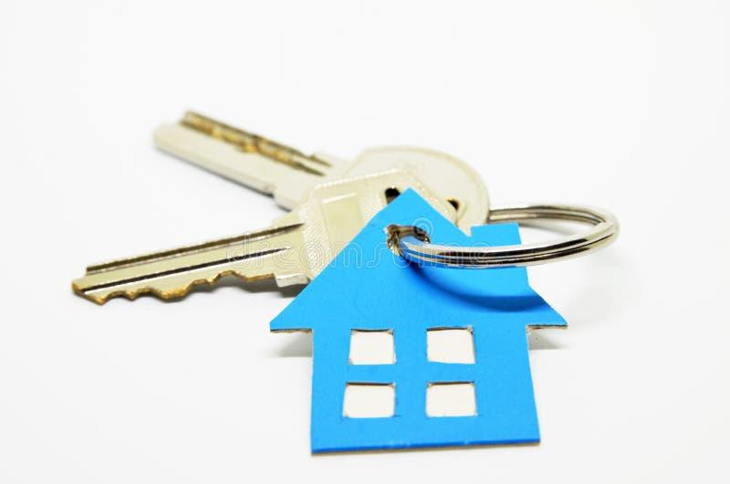 House keys with blue house keychain. Isolated stock image