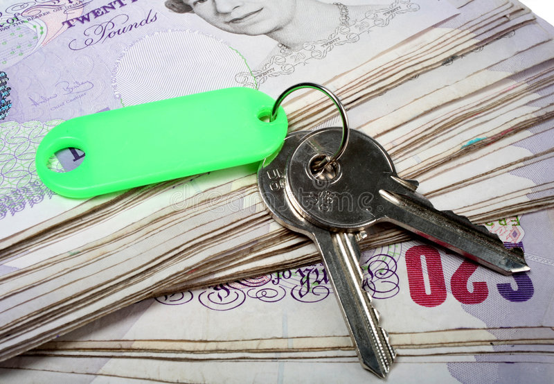 House keys and British pounds stock photo