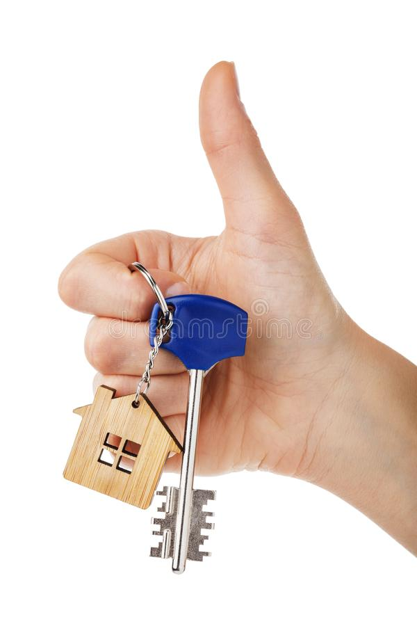 House keys in hand isolated on white background royalty free stock photography