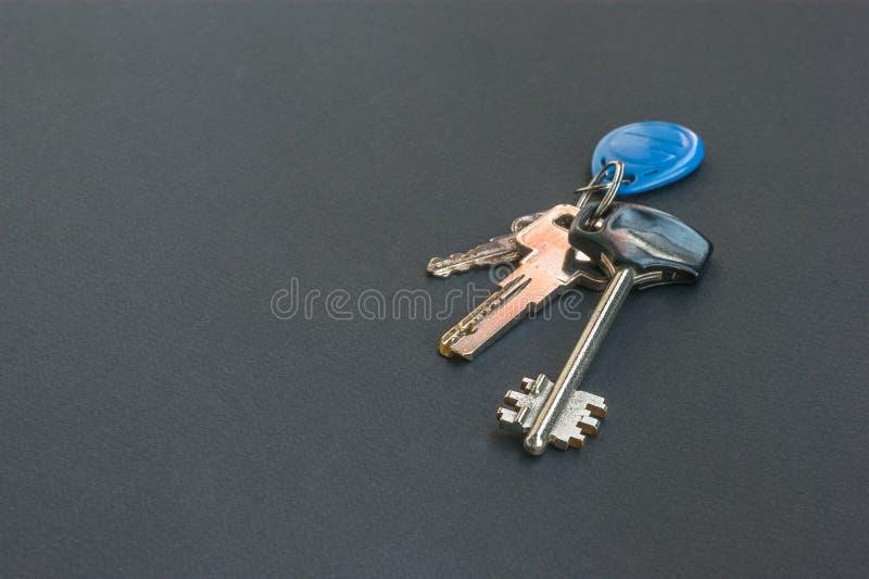 House keys House keys on a black table royalty free stock photos