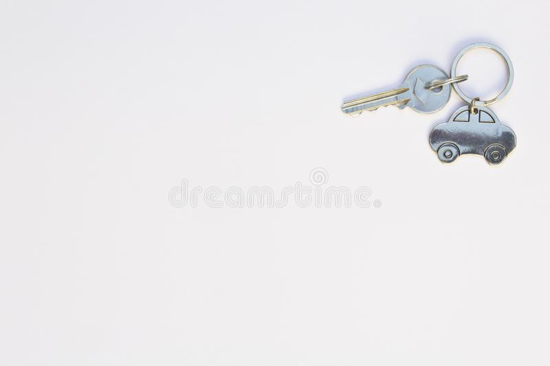 House keys and key chain isolated on white background. Copy space. royalty free stock image