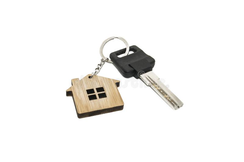 House keys with house shaped keychain, isolated white background royalty free stock image