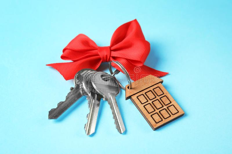 House keys with trinket and bow stock photography