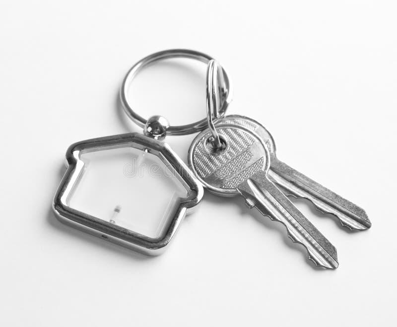 House keys with trinket royalty free stock image