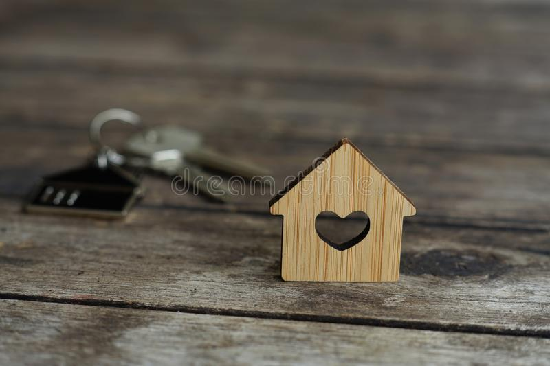 House keys with wooden home keying on wood table, copy space, property concept stock image
