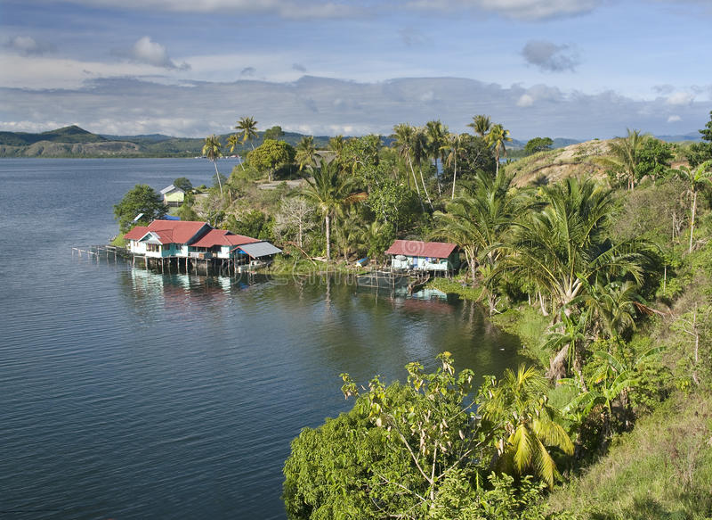 House on the lake. House on an island on the lake of Sentani, New Guinea stock photography
