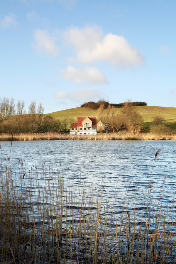 House by lake royalty free stock photography