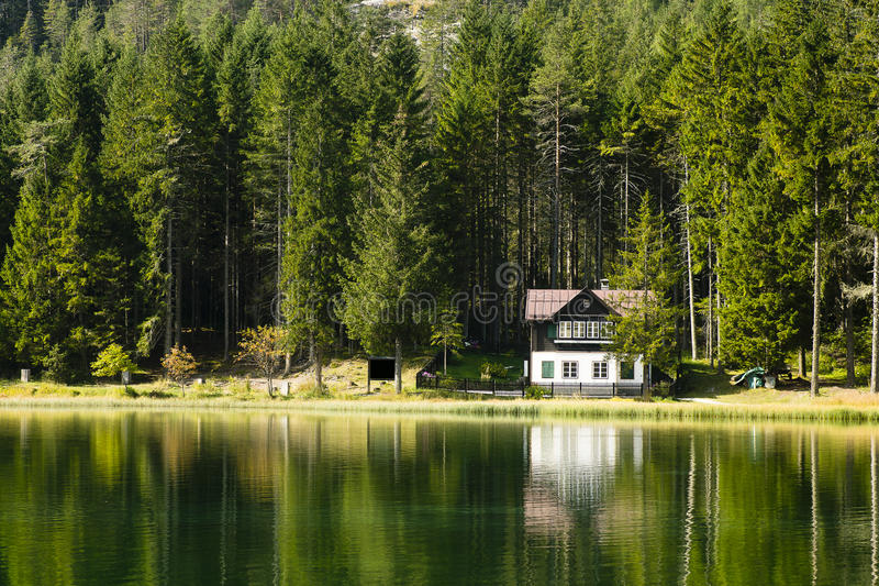 House on Lake Dobbiaco Dolomites Italy stock photography