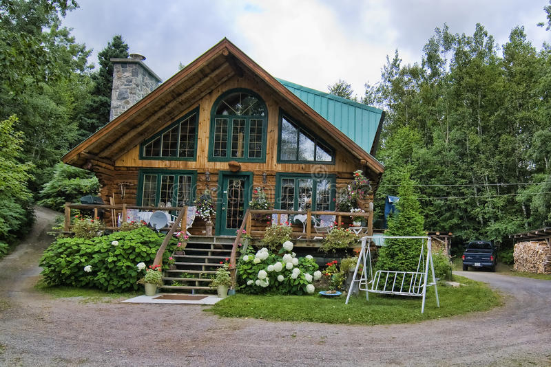 House at the Lake, Quebec, Canada. House in Tadoussac, Quebec, Canada, August 2008 stock image